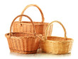 Empty wicker baskets isolated on white