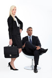 Studio shot of a smart business duo