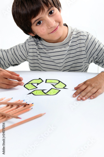 boy colouring recycling logo