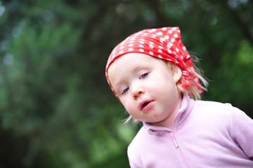 a girl in red bandana