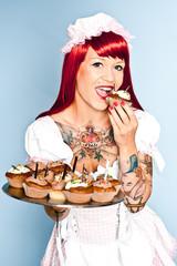 Hübsches Mädchen mit Muffins