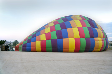 inflating a hot air balloon on the ground