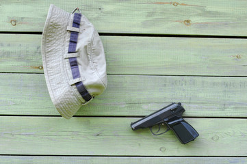 Hat and Pistol on the Wall