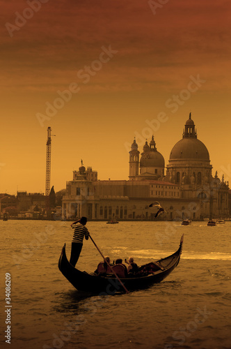 Fotobehang Gondolas Gondolier in Venice, Italy