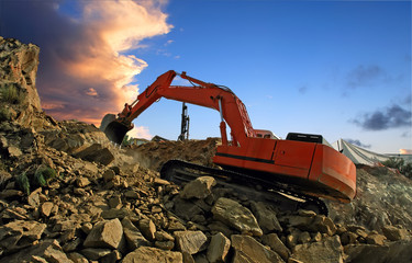 Excavator crushing rocks
