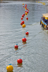 The wash from a ferry disturbs buoys in Bristol harbour UK