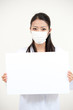 beautiful asian nurse taking mask with whiteboard