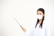 beautiful asian nurse taking mask pointing