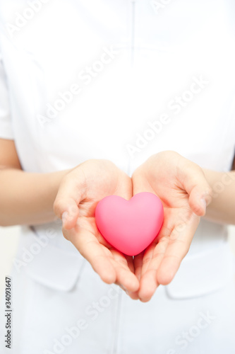 a nurse holding a symbol of heart