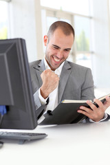 Closeup on successful businessman in office