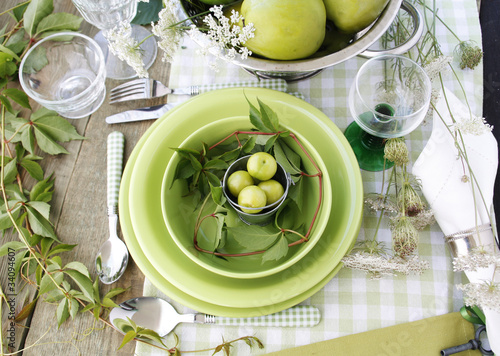 Summer table setting with green dinnerware