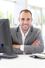 Portrait of satisfied businessman in office