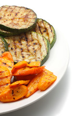 Grilled carrot and zucchini on а plate