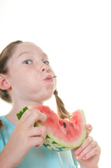 Girl spitting out watermelon seed