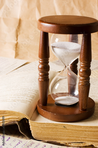 Deurstickers Retro Hourglass and the book