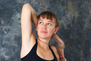 woman doing yoga exercise Kapotasana or King Pigeon Pose  agains