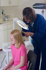 Nurse checking for head lice