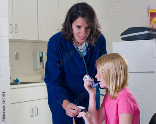 Asthma patient getting breathing treatment from nurse.