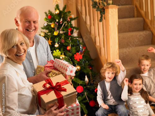 Senior couple with grandchildren at Christmas