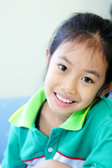 Cute young asian girl smiling