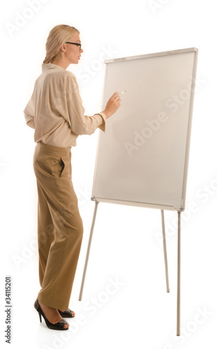 Woman in glasses standing in front of drawing board