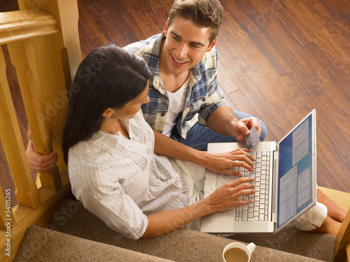 Young Hispanic couple shopping online