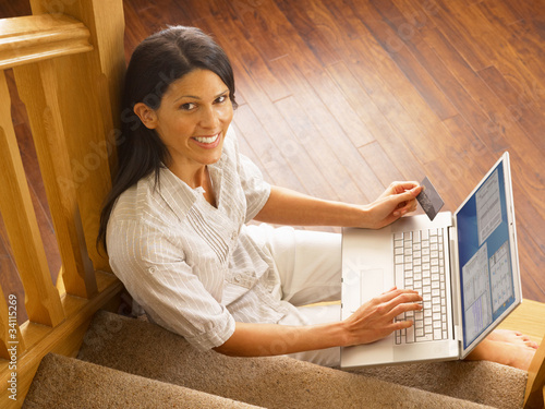 Young Hispanic woman shopping online