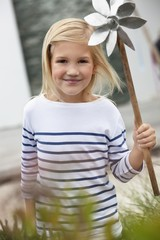Cute girl holding pinwheel