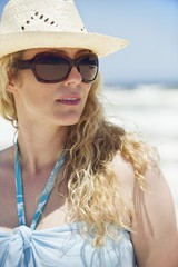 Mid adult woman wearing sunglasses and sunhat
