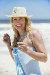 Portrait of a beautiful woman wearing sunhat and smiling