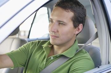 Mid adult man driving a car