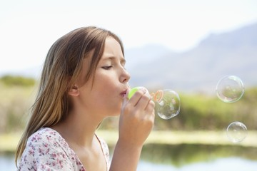 Close-up of a girl blowing bubbles