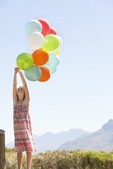 Girl playing with balloons