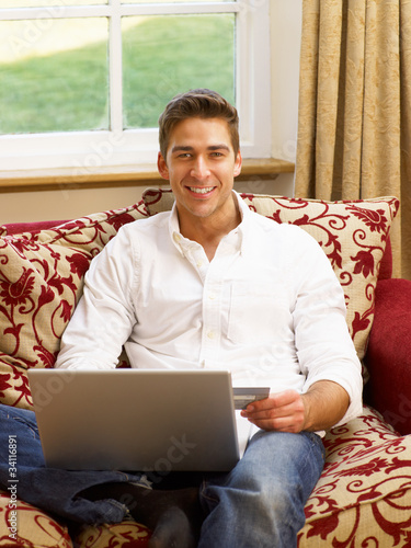 Young Hispanic man shopping online