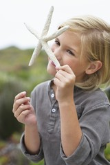 Close-up of a girl smelling a star shaped toy