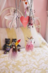 Close-up of wind chime decorated in a bedroom