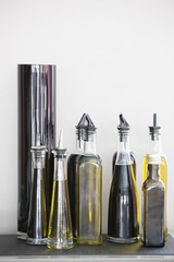 Assorted cooking oil bottles in a restaurant