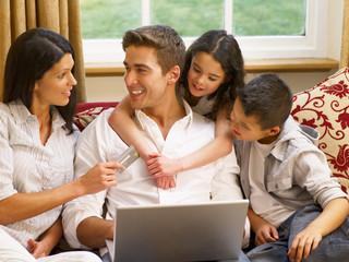 Hispanic family shopping online