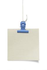 青い目玉クリップとメモ用紙