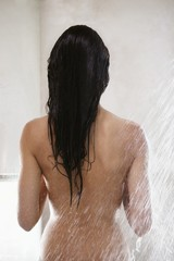 Rear view of woman taking a shower