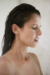 Close-up of a woman taking a shower