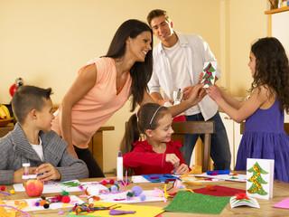 Hispanic family making Christmas cards
