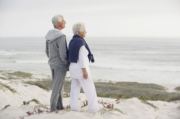 Side profile of a senior couple looking at the sea