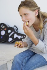 Close-up of a girl eating cookies and smiling