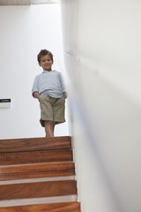 Boy standing on a staircase