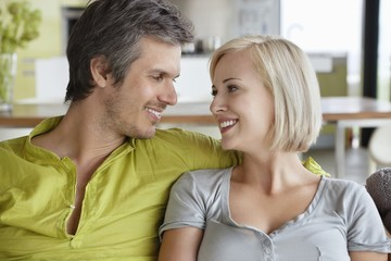 Close-up of romantic couple sitting together