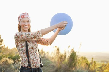 Beautiful woman playing with a balloon and smiling