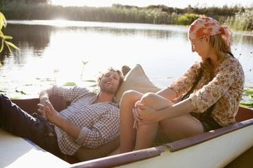 Young couple enjoying in the boat