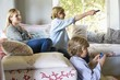 Children and mother using electronic gadgets at house