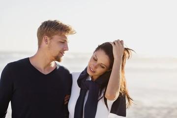 Man looking at his girlfriend on beach